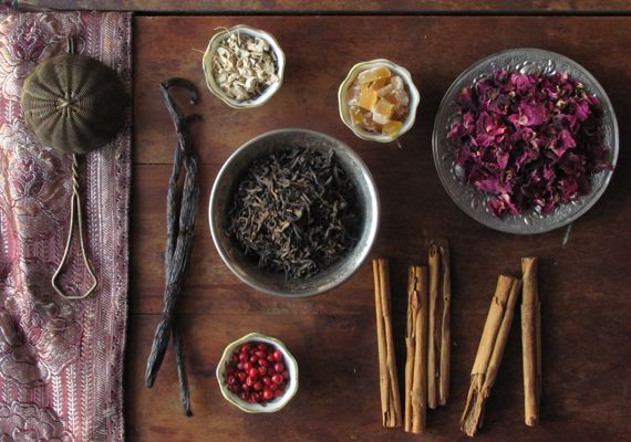 Vanilla bean, rose petals, cinnamon sticks and spices representing the different tastes of an ayurvedic diet.